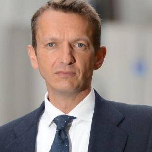 Andrew G Haldane